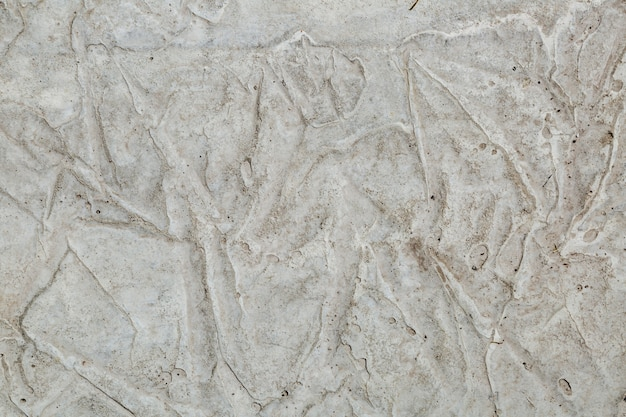Concrete wall texture with an uneven layer of putty textured
