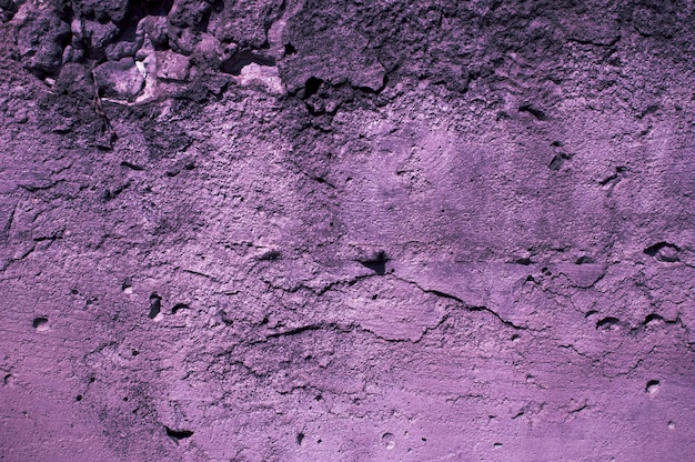 Concrete wall in violet light