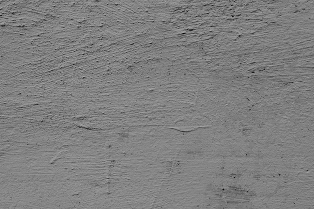 Concrete wall with cracks and scratches