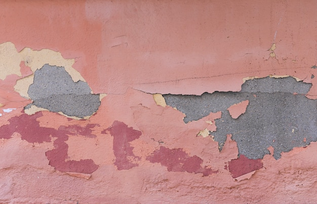 Concrete wall with paint and peeling