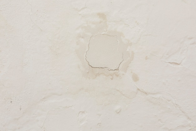 Concrete wall with plaster and cracks