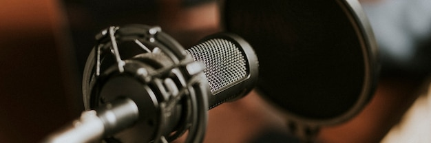 Condense microphone with a pop filter in a studio