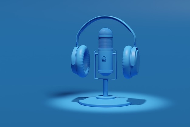 Condenser microphone, headphones isolated on a blue background.
