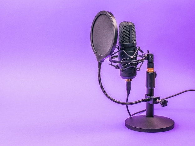 Condenser microphone with a diffuser on a purple surface