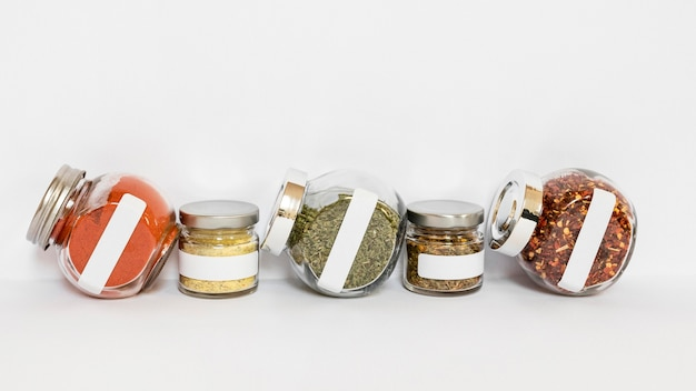 Condiments jars on white background