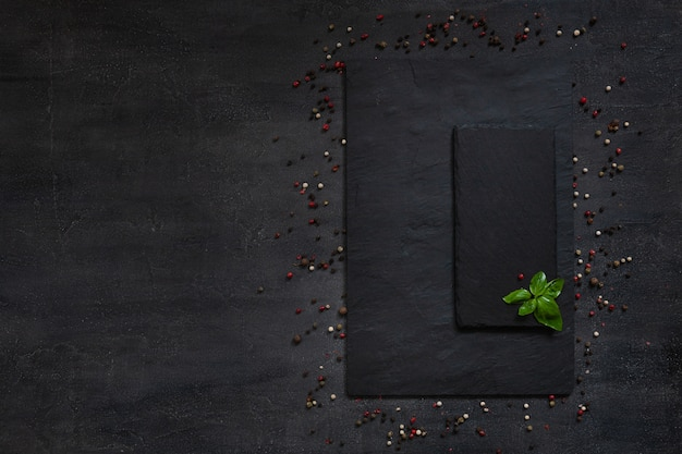 Condiments and spices on quadratic stone board