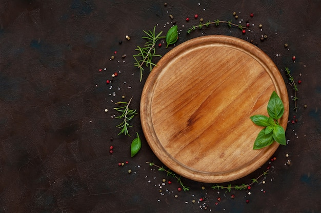 Condiments and spices on round wooden board. top view, close-up on vintage wooden background