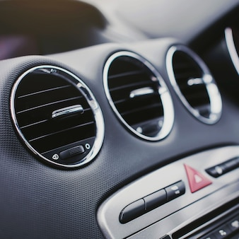 Conditioner system in modern car interior.