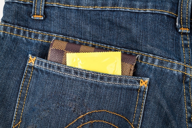 Condoms and billfold in jeans pocket