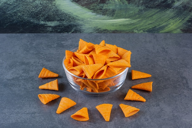 Cone chips in a glass bowl on the marble surface