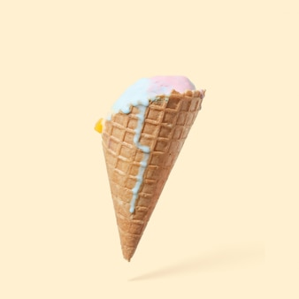 Cone of melted ice cream, on a yellow background