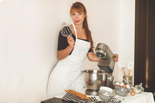 Confectioner girl preparing a cake
