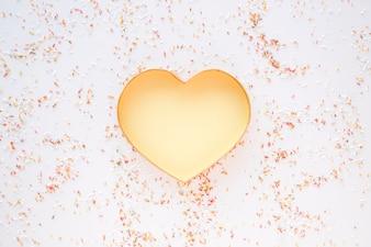 Confetti around golden heart