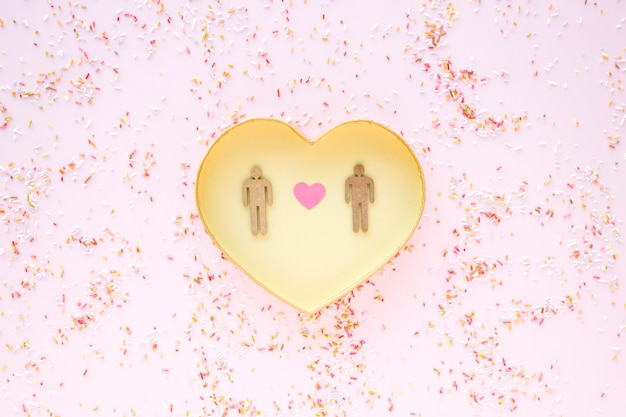 Confetti around heart with gay couple