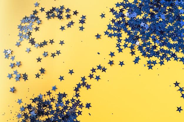 Confetti glitter on illuminating color pastel festive