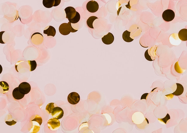 Confetti at new years party with pink background