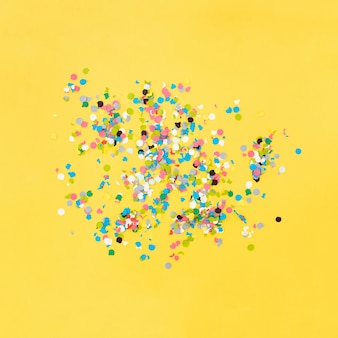Confetti on yellow background after the party