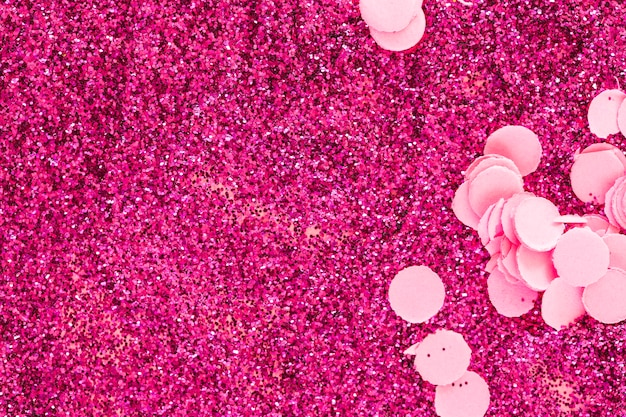 Confetti on pink glitters