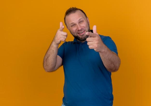 Confident adult slavic man doing you gesture