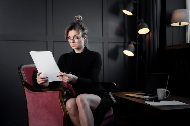 Confident adult woman checking some papers