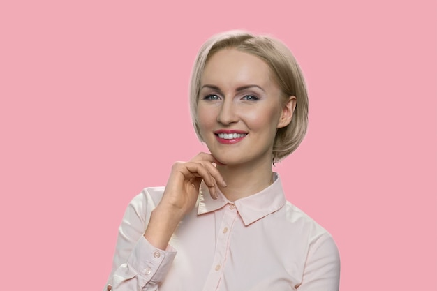 Confident american busineswoman. middle-aged woman with short haircut isolated on pink background.