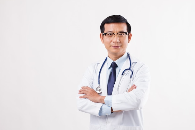 Confident asian male doctor isolated