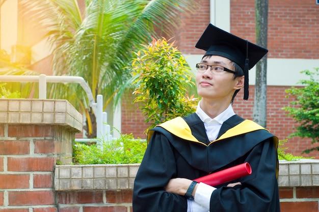 Confident asian university graduate
