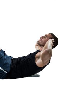 Confident athlete doing crunches