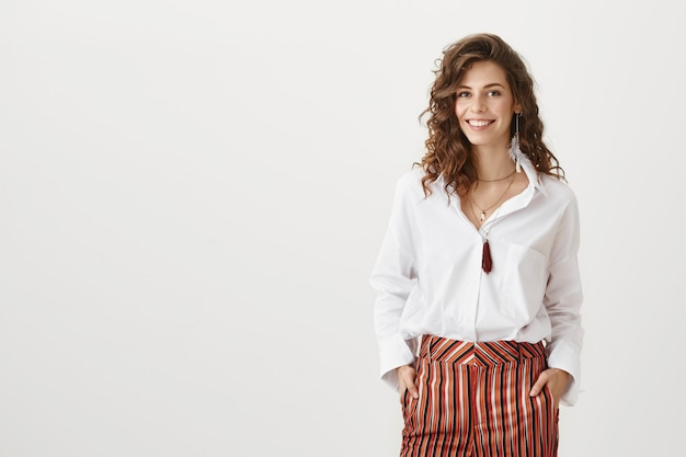 Confident attractive female entrepreneur smiling