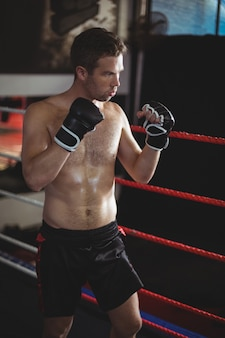 Confident boxer performing boxing stance