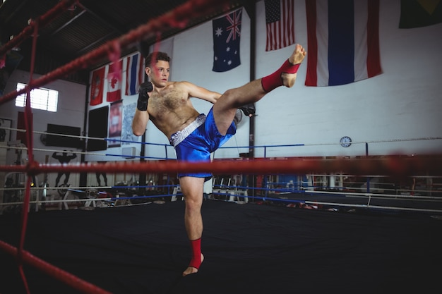 Confident boxer practicing a boxing