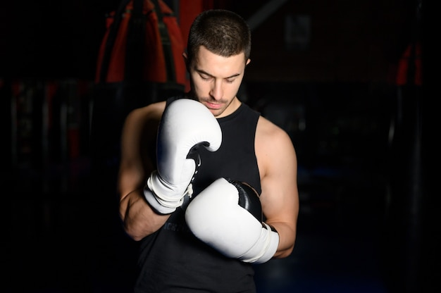 Confident boxer standing in pose and ready to fight.