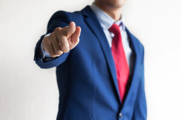 Confident business manager pointing at camera