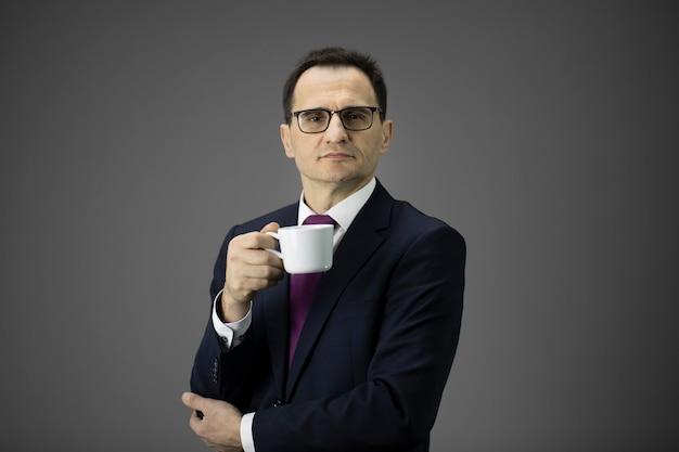 Confident business owner with morning coffee cup looking at camera, copy space