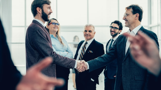 Confident business people shaking hands with each other. the concept of cooperation