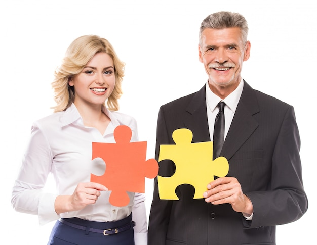 Confident business people wanting puzzle together.