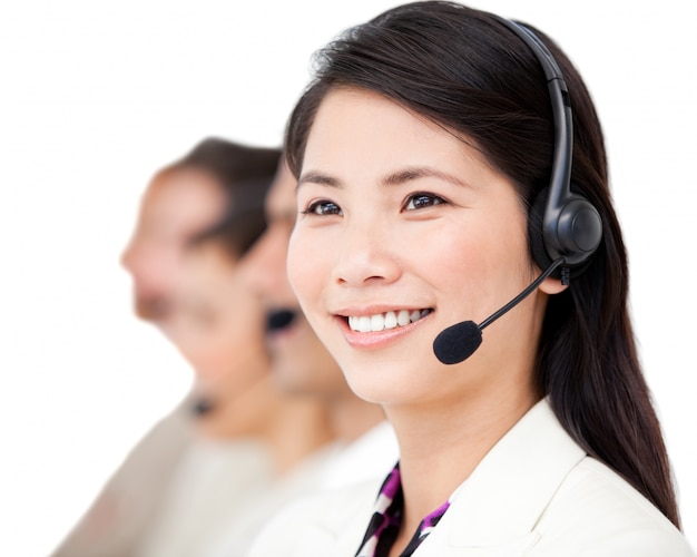 Confident business people with headset on standing