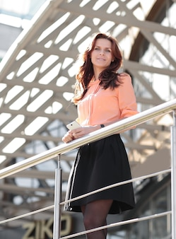 Confident business woman standing on the balcony of a modern office building.photo with copy space
