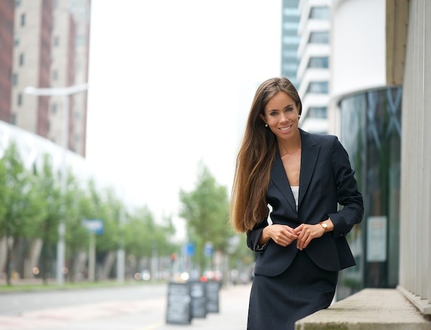 Confident business woman standing outdoors