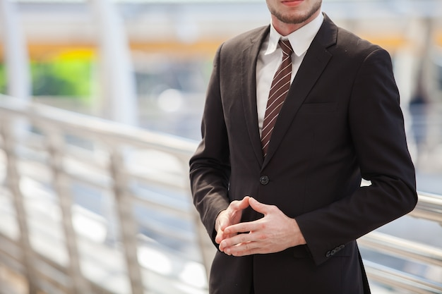 Confident businessman. confident young man in full suit looking away