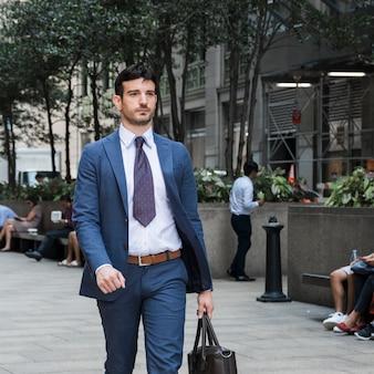 Confident businessman going to work