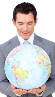 Confident businessman holding a terrestrial globe