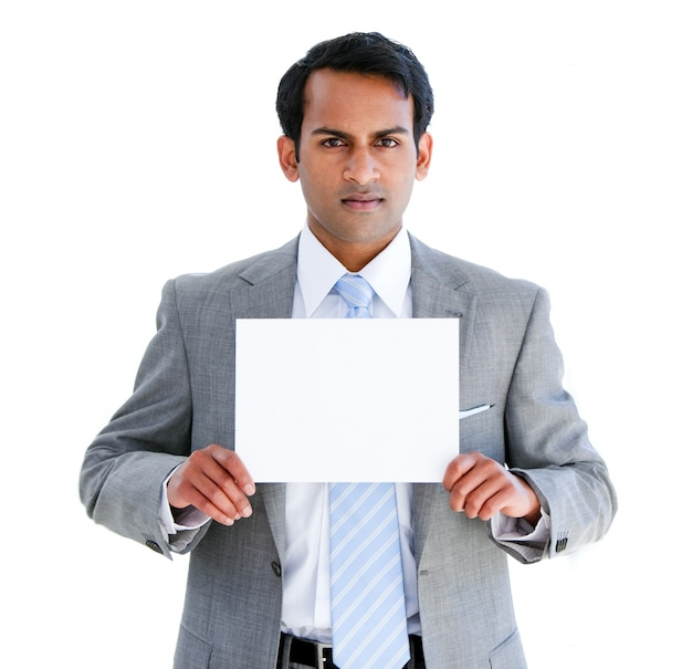 Confident businessman showing a note