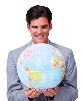 Confident businessman smiling at global business expansion