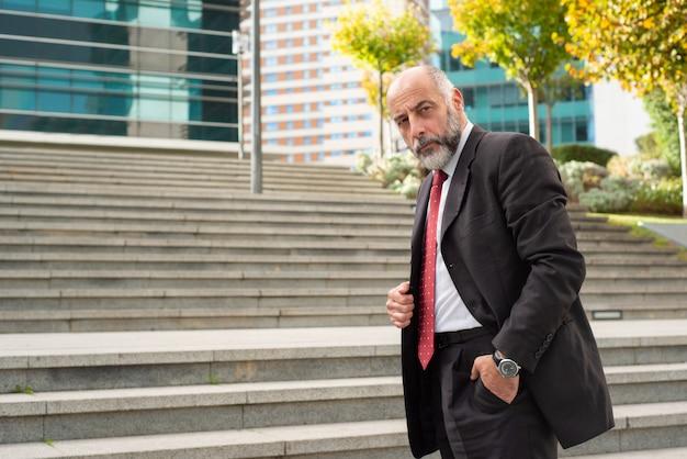 Confident businessman standing on street