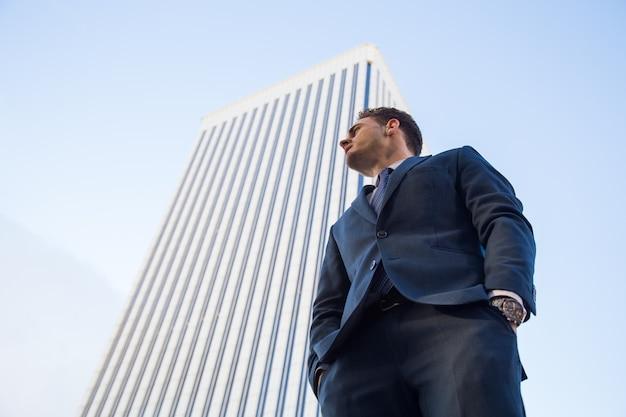 Confident businessman on urban scene.