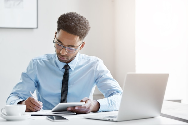 Confident businessman working on his laptop