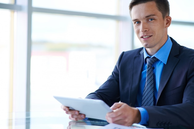 Confident businessman working with a tablet