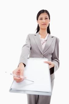 Confident businesswoman asking for signature