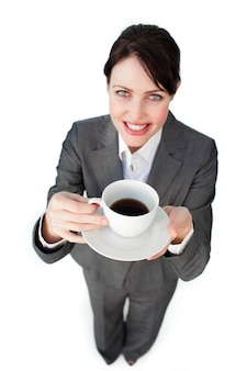 Confident businesswoman drinking a cup of coffee